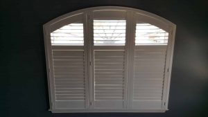 What Is the Difference Between Roman Shades and Plantation Shutters?